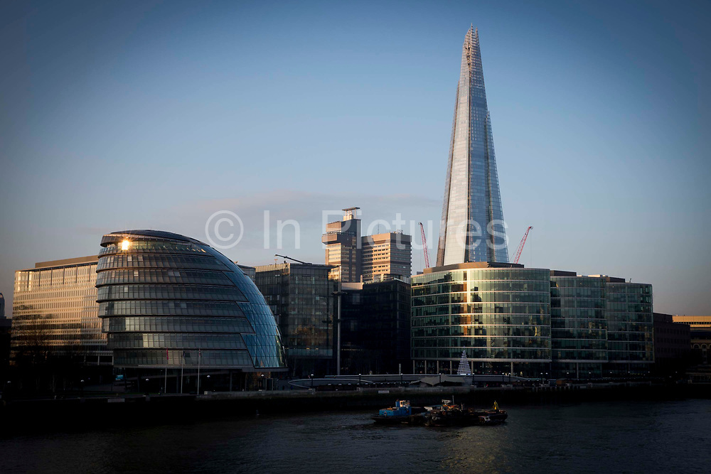 The Shard and City Hall overlooking the Thames in Central London, United Kingdom. City Hall has developed nicknames such as 'The Onion' and 'The Snail'.