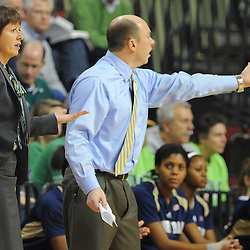 Notre Dame Fighting Irish head coach Muffet McGraw and assistant coach Jonathan Tsipis react to a play during second half NCAA Big East women's basketball action between Notre Dame and Rutgers at the Louis Brown Athletic Center. Notre Dame defeated Rutgers 71-41.