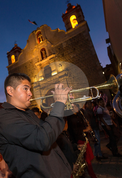 Mexican musicians parade through the streets during the Day of the Dead Festival known in spanish as Día de Muertos on October 30, 2014 in Oaxaca, Mexico.