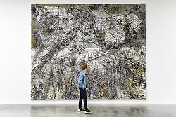 """© Licensed to London News Pictures. 14/11/2019. LONDON, UK. A visitor views """"Raum-Zeit"""", 2019, by Anselm Kiefer at the preview of a new exhibition called """"Superstrings, Runes, The Norns, Gordian Knot"""" by Anselm Kiefer.  The works include large scale paintings and installations that draw on the scientific concept of string theory and are on display at the White Cube Gallery in Bermondsey 15 November to 26 January 2020.  Photo credit: Stephen Chung/LNP"""