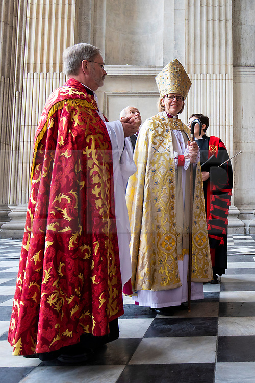 © Licensed to London News Pictures. 12/05/2018. London, UK. The Rt Revd and Rt Hon Dame Sarah Mullally DBE (R) arrives at Saint Paul's Cathedral for a service which will install her as the 133rd Bishop of London.  The service coincides with International Nurses Day, Florence Nightingale's birthday, echoing Bishop Sarah's own former career in the NHS as a nurse, including as Chief Nursing Officer, before her ordination. Photo credit: Rob Pinney/LNP