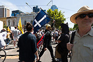 A gladiator is seen holding a Eureka flag during the Melbourne Freedom Rally at Parliament House. Police move into position on the steps of state parliament ahead of a planed protest. The groups who have organised the many Freedom Day protests over the last 3 months, attempted to march on State Parliament during Melbourne Cup Day demanding the sacking of Premier Daniel Andrews for the lockdown and attacks on their civil liberties. Police met with the protester's with significant force despite the city having had zero cases for five days. (Photo by Dave Hewison/Speed Media)
