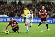 Leon Britton of Swansea city ©  is fouled by Karl Henry  of QPR (l) Barclays Premier league match, Swansea city v Queens Park Rangers at the Liberty stadium in Swansea, South Wales on Tuesday 2nd December 2014<br /> pic by Andrew Orchard, Andrew Orchard sports photography.