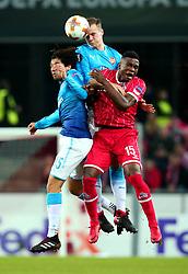 Rob Holding of Arsenal beats teammate Mohamed Elneny of Arsenal and Jhon Cordoba of Cologne to a header - Mandatory by-line: Robbie Stephenson/JMP - 23/11/2017 - FOOTBALL - RheinEnergieSTADION - Cologne,  - Cologne v Arsenal - UEFA Europa League Group H