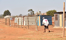 South Africa - Johannesburg - 17 August 2020 - A resident of Patsing informal settlement near Lenasia, south of Johannesburg, is seen walking to were she is staying, residents occupied land illegally in recent years, protested after learning of allegations that they will be forcefully remove soon,residents vowed no one will touch their homes after three failed attempts from the Johannesburg Metro Police Department(JMPD) in recent times. Residents protested asMayor Geoff MakhuboandGauteng's Cooperative Governance MEC Lebogang Maile were launchingthe province's anti-land invasion strategy.<br /> Picture: Itumeleng English/African News Agency(ANA)