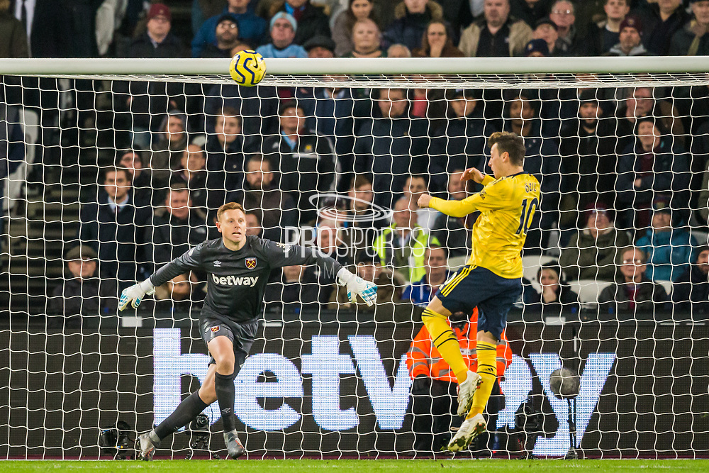 David Martin (GK) (West Ham) saves a ball from Mesut Ozil (Arsenal) during the Premier League match between West Ham United and Arsenal at the London Stadium, London, England on 9 December 2019.