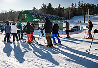 Skiers and riders adjust to the new norm of social distancing through the lift line to the Panorama Quad on Friday morning at Gunstock Mountain.  (Karen Bobotas Photo/for The Laconia Daily Sun)