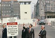 President Reagan visit to Checkpoint Charlie with Chancellor Helmut Schmidt and Richard von Weizsacker in West Berlin, <br />Photo by Dennis Brack. bb77