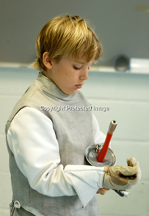Gerrit Swart, 9, prepares for a Cape Fear Fencing Association youth fencing tournament at Tileston Gym in Wilmington, N.C. Saturday May 31, 2014. (Jason A. Frizzelle)