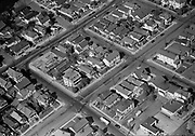 Ackroyd 02442-3. aerials. September 28, 1950. houses near SW 5th & Caruthers. (upper left is Pete's Garden Shop, 2324 SW 6th,  on right is Chet's Bar-B-Q 2319 SW 4th. Area shown, from left to right, is SW 6th, 5th & 4th. From top to bottom, SW Grant, Sherman & Caruthers. View looking northwest.)