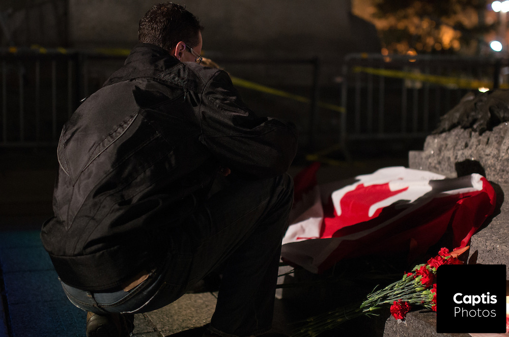 A man pays his respects to Cpl. Nathan Cirillo at the National War Memorial. Cirillo was fatally shot the day before at the memorial. October 23, 2014.