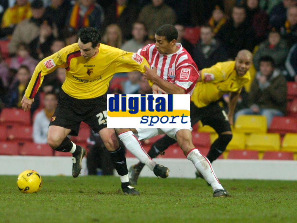 Photo: Leigh Quinnell.<br /> Watford v Stoke City. Coca Cola Championship.<br /> 14/01/2006. Watfords Matthew Spring cant get away from Stokes Karl Henry.