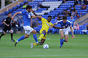 Peterborough United midfielder Michael Bostwick (4) and Peterborough United defender Jack Baldwin (6) tussle with AFC Wimbledon striker Dominic Poleon (10) during the EFL Cup match between Peterborough United and AFC Wimbledon at ABAX Stadium, Peterborough, England on 9 August 2016. Photo by Stuart Butcher.