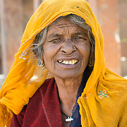 Portrait of Rajasthani woman with yellow headscarf