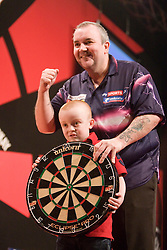 Phil Taylor presents a fan withthe board after he beats Ronnie Baxter..2010 Whyte & MacKay Premier League Darts week nine, Glasgow SECC..©2010 Michael Schofield. All Rights Reserved.
