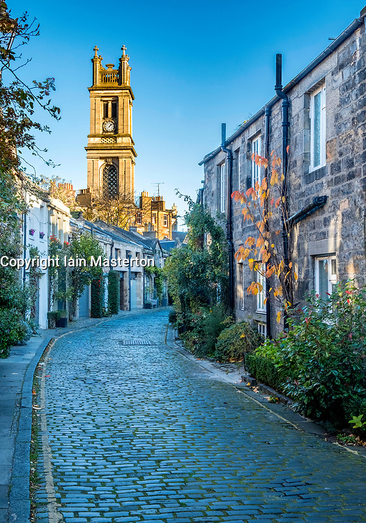 View along traditional row of mews houses towards St Stephen's Church  in Circus Lane in Stockbridge district of New Town in Edinburgh, Scotland, United Kingdom.