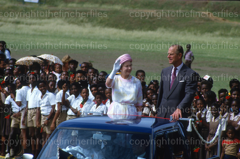 Her Majesty Queen Elizabeth with husband Prince Philip, The Duke of Edinburgh as they tour St.Kitts in the Caribbean in October 1985. Photograph by Terry Fincher