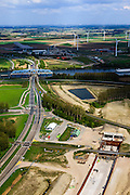 Nederland, Zeeland, Zeeuws-Vlaanderen, 09-05-2013; Sluiskil, Kanaal Gent-Terneuzen, kanaalkruising Sluiskil. Bouwput van de tunnel in aanbouw.<br /> De brug in de N61 sluit zeer regelmatig voor zeeschepen en dit veroorzaakt files. Daarom zal de kanaalbrug vervangen worden door een tunnel, de Sluiskiltunnel (oplevering 2015).<br /> The pivot bridge over the canal Gent-Terneuzen (Zeeland) closes very regularly for seagoing vessels and this causes traffic jams. Therefore, the canal bridge will be replaced by a tunnel, the tunnel Sluiskil (completion 2015).<br /> luchtfoto (toeslag op standard tarieven);<br /> aerial photo (additional fee required);<br /> copyright foto/photo Siebe Swart.