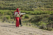 Local indigenous people, walking to the local market. Bale Mountains, Ethiopia, Africa