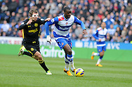 Reading's Hope Akpan is challenged by Wigan's James McCarthur. Barclays Premier league, Reading v Wigan Athletic at the Madejski Stadium in Reading on Saturday 23rd Feb 2013. pic by Andrew Orchard, Andrew Orchard sports photography,