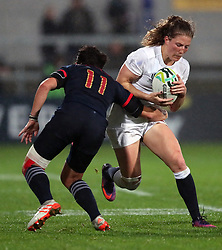 England Women's Lydia Thompson is tackled by France Women's Shannon Izar during the 2017 Women's World Cup, Semi Final match at the Kingspan Stadium, Belfast.