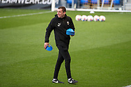 AFC Wimbledon coach Rob Tuvey setting up cones during the EFL Sky Bet League 1 match between AFC Wimbledon and Gillingham at Plough Lane, London, United Kingdom on 23 February 2021.
