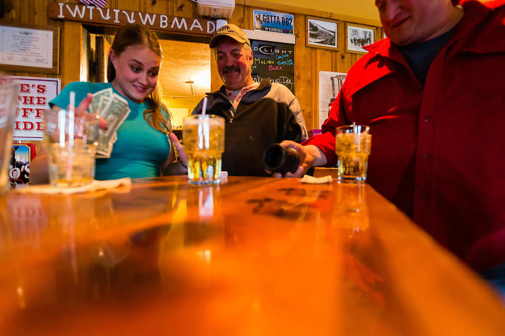 Patrons of the Stagecoach Bar in Wilson, Wyoming roll to see if they win the local make your day pot of $611.