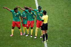 Cameroon's Augustine Ejangue (left to right), Gabrielle Aboudi Onguene (second left), Ajara Nchout (centre) and Gaelle Enganamouit (second right) appeal to match referee Qin Liang (right) after England's second goal was given by VAR after an offside call during the FIFA Women's World Cup, round of Sixteen match at State du Hainaut, Valenciennes.