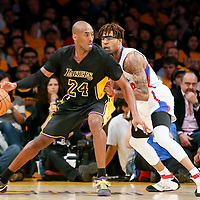31 October 2014: Los Angeles Lakers guard Kobe Bryant (24) posts up Los Angeles Clippers guard Chris Douglas-Roberts (14) during the Los Angeles Clippers 118-111 victory over the Los Angeles Lakers, at the Staples Center, Los Angeles, California, USA.