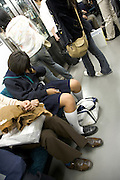 Japan school girl in uniform sleeping on the train