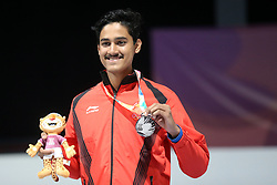 BUENOS AIRES, Oct. 8, 2018  Silver medalist Shahu Tushar Mane of India poses for photos during the awarding ceremony of the Men's 10m Air Rifle Final at the 2018 Summer Youth Olympic Games in Buenos Aires, capital of Argentina, Oct. 7, 2018. (Credit Image: © Li Ming/Xinhua via ZUMA Wire)