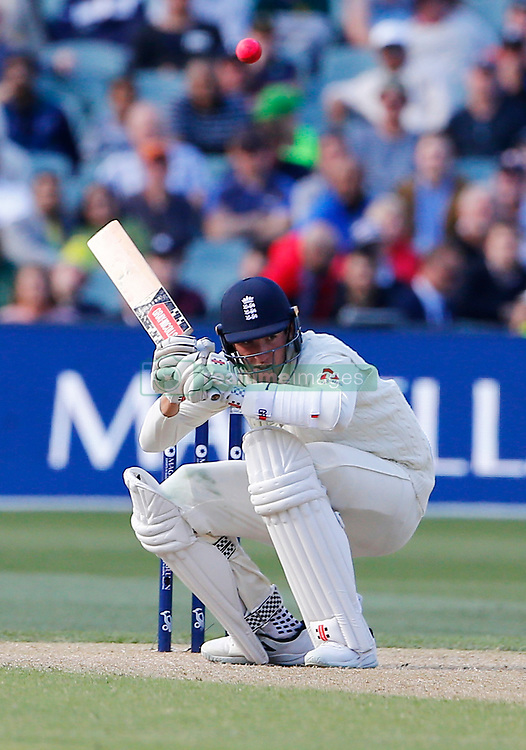 England's Craig Overton ducks a bouncer during day three of the Ashes Test match at the Adelaide Oval, Adelaide.