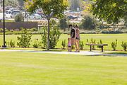 Family Walking Along the Sidewalk at Sendero Field Park of Rancho Mission Viejo