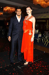 Malaysian Fashion designer BERNARD CHANDRAN and model VERA SMIRNOVA at the charity Vanishing Herd Foundation - Conservation Ball held at the Radison Hotel, Portman Square, London on 13th November 2004.<br />