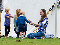 © Licensed to London News Pictures. 14/06/2015. Prince George of Cambridge and his mother Catherine Duchess of Cambridge talking to Autumn Phillips  and Daughter Savannah Phillips.. British Royals attend a charity Polo match in Tetbury,  Gloucestershire, UK. Photo credit: Ben Cawthra/LNP