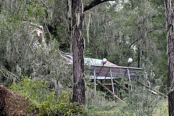 An advertisement sing fell between Spanish moss covered trees along interstate 75, in Northern Florida, on September 11, 2017. Flood water resides from parts of Jacksonville, FL after Hurricane Irma took an unexpected turn and caused massive power outages and coastal flooding around the state.