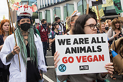 Animal rights activists from Animal Rebellion and other groups take part in a National Animal Rights March on 28th August 2021 in London, United Kingdom. Animal Rebellion, an offshoot of Extinction Rebellion, organised the march for the sixth day of Extinction Rebellion's protests in London, with stops at Smithfield meat market, Unilever (which owns brands that sell dairy products and use palm oil), Cargill (which is one of the world's largest meat processors) and the Marine Stewardship Council.