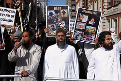 "© Licensed to London News Pictures.  11/09/2011. LONDON, UK. Muslims Against Crusades (MAC), led by Anjem Choudary (pictured centre) chants ""Burn Burn USA"" outside the US Embassy in Grosvenor Square, London. The demonstration is timed to coincide with the 10 year anniversary of the September 11 attacks in New York. Photo credit :  Cliff Hide/LNP"