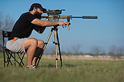Johny Hendricks works on sighting a new scope outside of Mansfield, Texas on March 9, 2014.