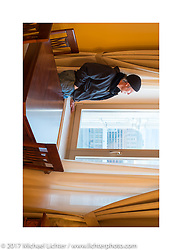 Jonathan Pite in Vasily Kostin's apartment in the Kotelnicheskaya Embankment Building, one of the 7-sisters Stalinist structures around Moscow, Russia. Sunday April 23, 2017. Photography ©2017 Michael Lichter.