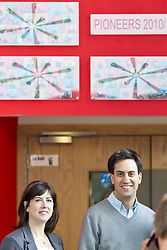 © Licensed to London News Pictures. 29/09/2012. Manchester, UK . Left to right: Labour candidate Lucy Powell and Ed Miliband arrive at the venue. Ed Miliband holds an open Q&A session with members of the public at The East Manchester Academy , ahead of the Labour Party Conference . Photo credit : Joel Goodman/LNP