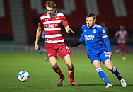Doncaster Rovers defender Tom Anderson (4) defends from Ipswich Town forward Freddie Sears (20) pressure during the EFL Sky Bet League 1 match between Doncaster Rovers and Ipswich Town at the Keepmoat Stadium, Doncaster, England on 20 October 2020.