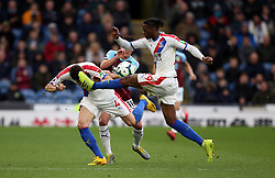 Burnley's Ashley Westwood battles for the ball with Crystal Palace's Luka Milivojevic (left) and Aaron Wan-Bissaka (right) during the Premier League match at Turf Moor, Burnley.