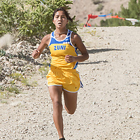 Zuni High School senior Shante Natewa picks up the pace as she makes her way to the finish line. Natewa took first place at the Tohatchi Invitational Cross Country Meet at Hamburger Hill in Tohatchi, NM.