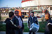 """Father Abdush (2nd left) and his sons Mersid (left), Erdal (3rd left) and Ergul preparing for a drum session on a stage in front of the """"House of Culture"""" in Delcevo, Macedonia. The Roma family - father and his 3 sons - are well know for their drum perfomances and also they build their drums themselves."""