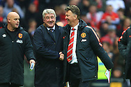 Hull's manager, Steve Bruce and Louis Van Gaal, manager of Manchester United enjoy a joke - Manchester United vs. Hull City - Barclay's Premier League - Old Trafford - Manchester - 29/11/2014 Pic Philip Oldham/Sportimage