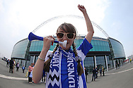 a Young Sheffield Wednesday fan blowing horn outside Wembley Stadium before k/o.  Skybet football league Championship play off final match, Hull city v Sheffield Wednesday at Wembley Stadium in London on Saturday 28th May 2016.<br /> pic by John Patrick Fletcher, Andrew Orchard sports photography.