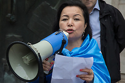 London, UK. 5th August, 2021. Rahima Mahmut, London-based Uyghur singer, translator and human rights activist, addresses activists from Uyghur Solidarity Campaign UK and other supporting groups protesting opposite the Chinese embassy in support of the Uyghur people's struggle for freedom. Activists highlighted the Chinese government's persecution and forced assimilation of Uyghurs, Kazakhs and other indigenous people in East Turkestan and Xinjiang and called for them to have the right to determine their own futures through a democratic process.