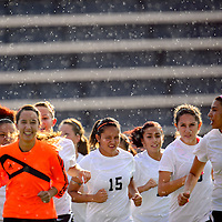 082713       Adron Gardner/Independent<br /> <br /> The Gallup Lady Bengals varsity soccer team jogs through the rain before a match against the Navajo Prep Eagles at Public School Stadium in Gallup Tuesday.