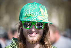 © Licensed to London News Pictures. 20/04/2016. London, UK. A man smokes cannabis at the '4/20' demonstration in Hyde Park. Demonstrators celebrate on 20 April for the legalisation of Cannabis. Photo credit : Tom Nicholson/LNP